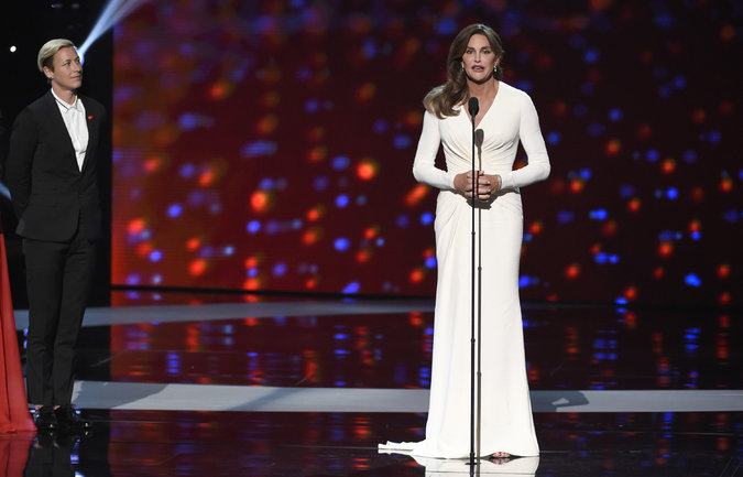 Ms. Jenner, in a white goddess gown, accepted an award for courage at the event in Los Angeles on Wednesday. Credit Chris Pizzello/Invision, via Associated Press